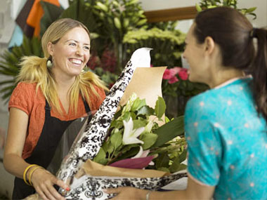 Florist giving flowers to customer